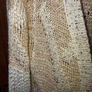 Cream colored Confess sequined open front sweater